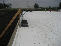 Laid foam insulation and 48,000 feet of in-floor-heat tubing